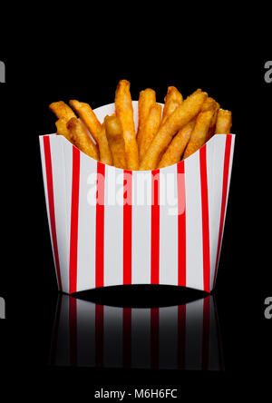 Southern french fries in paper container on black background - Stock Photo
