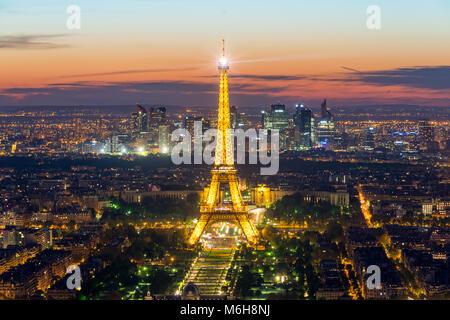 PARIS, FRANCE - May 5, 2016: Beautiful Paris skyline view Eiffel tower during light show at dusk, Paris, France - Stock Photo