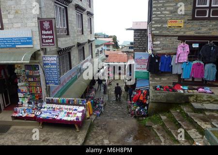 Shops and market stalls in Namche Bazaar town center, Everest Base Camp trek, Nepal - Stock Photo