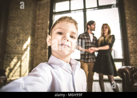 Family home portrait. Parents and son spending time together - Stock Photo