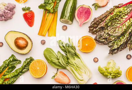 Healthy fruits and vegetables ingredients on white desk background, top view, flat lay, pattern. Healthy clean and - Stock Photo