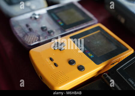 Two Nintendo Game Boy Color in different color - Stock Photo