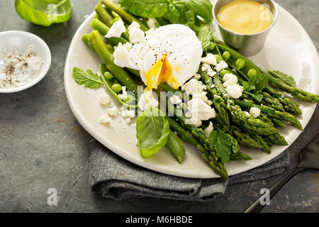 Green peas and asparagus with poached egg - Stock Photo