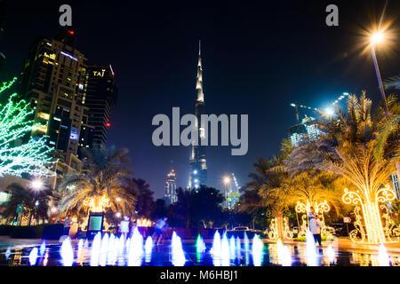 Dubai, United Arab Emirates - October 18, 2017: Dubai night scene with mega tall skyscraper Burj Khalifa view and - Stock Photo