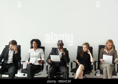 Nervous stressed job applicants preparing for interview waiting  - Stock Photo