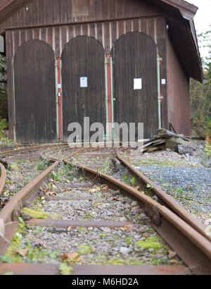 Rail tracks leading up to a train garage at Konnerud Mining Museum in Norway - Stock Photo