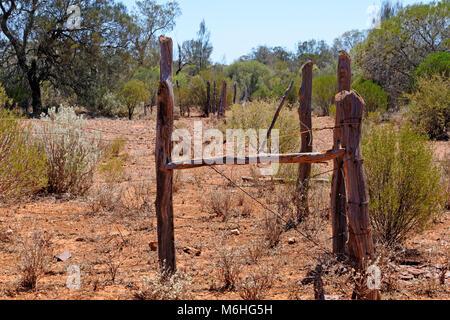 Old fence in Australian outback, Eastern Goldfields, Western Australia. - Stock Photo
