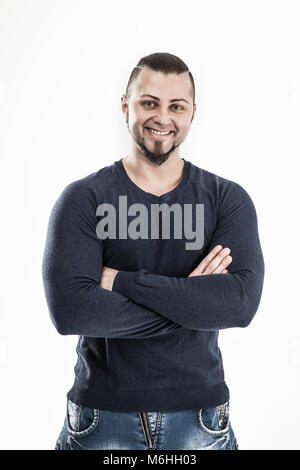 portrait of a sporty guy - bodybuilder in jeans and a t-shirt on - Stock Photo