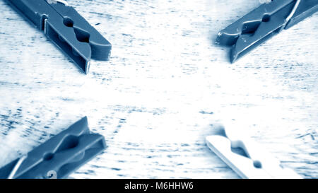 Clips for drying clothes indoors and outdoors. Holders wet cloth - Stock Photo