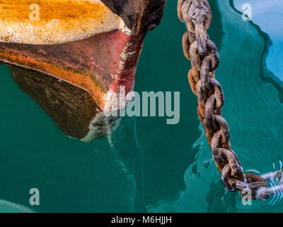 Docked fishing boats on Procida Island, Italy - Stock Photo