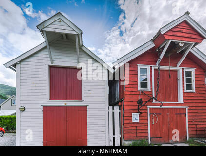 reconstruction of traditional old wooden sheds in Vik, Norway, Sognefjorden, wooden houses rebuilt after burn - Stock Photo