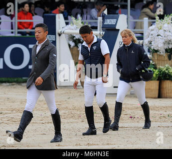 Riders walk the course at the FEI jumping event in Chaoyang park, Beijing, China, in October 2016 - Stock Photo