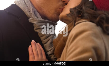 Sweet young couple kissing tenderly on first date, romance and relationship - Stock Photo