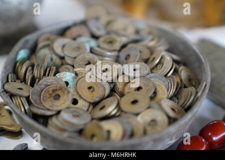 Many old pennies (called delikli kurus in Turkish) in a bowl - Stock Photo