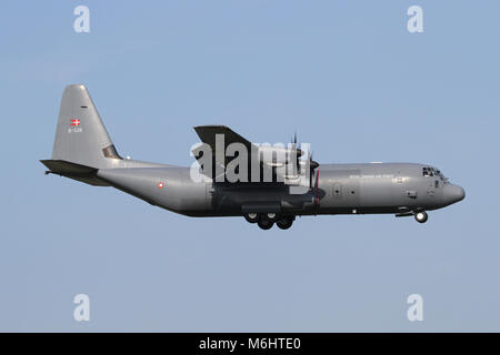 Royal Danish Air Force C-130J Hercules on approach in RAF Mildenhall during a joint exercise. - Stock Photo