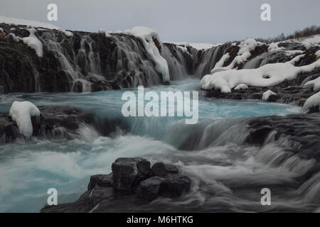 Inside Bruearfoss blue waterfall in Iceland - Stock Photo