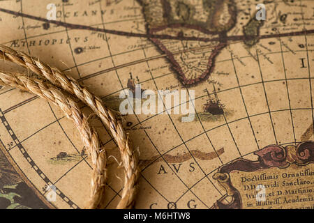 Rope on the old map. Retro style - Stock Photo