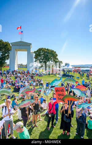Climate change knows no borders. International rally at Canada U.S Peace Arch border crossing. - Stock Photo