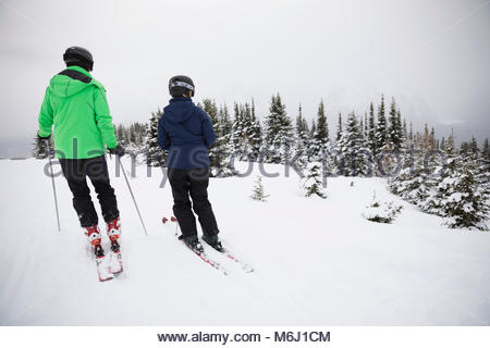 Couple skiing in snow - Stock Photo