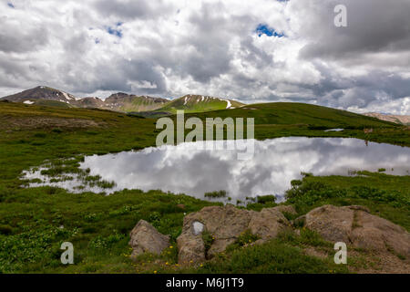 Beautiful stormy daylight scenic vista from high altitude Independence Pass in Rocky mountains of Colorado cloud - Stock Photo