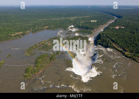Full river view Iguazu Falls waterfall rainbow border Brazil Argentina, Paraguay UNESCO world heritage site natural - Stock Photo