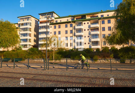 Cyclist motion blur, Hammarby Sjostad eco neighbourhood a pioneer in sustainable development, Hammarby Lake, Stockholm, - Stock Photo