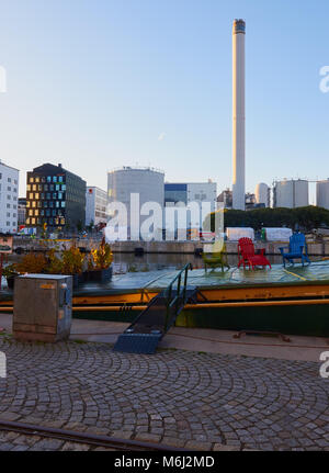Chairs on deck of barge at sunrise, Hammarby Sjostad eco neighbourhood a pioneer in sustainable development, Hammarby - Stock Photo