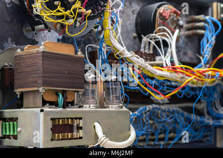 Transformer, radio tubes and wires. Old radio lamp device. Lamp receiver. Inside view. Selective focus - Stock Photo