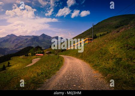 Colorful landscape in the Jungfrau region with the mountain train from Lauterbrunnen to Kleine Scheidegg. Wengen, - Stock Photo