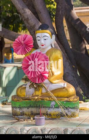 Buddha statue in the grounds of Ananda Pagoda, Ananda Temple at Bagan, Myanmar (Burma), Asia in February - Stock Photo