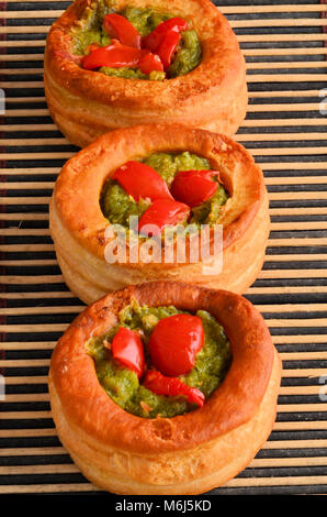 Vol-au-vent with mushroom and chicken, on bamboo - Stock Photo