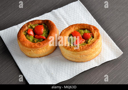 Vol-au-vent with mushroom and chicken, on white paper - Stock Photo