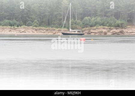 Boat on Misty Waters - Stock Photo