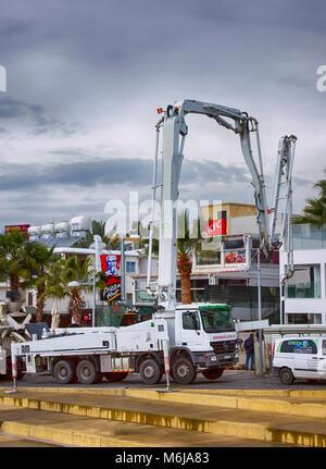 Paphos, Cyprus - December 20, 2013 Crane car working on construction site near KFC restaurant on Paphos street. - Stock Photo