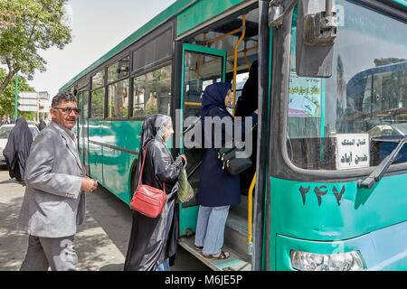 Kashan, Iran - April 27, 2017: Passengers enter the municipal bus at a public transport stop. - Stock Photo
