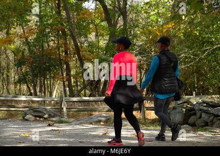 Two women walking on nature trail - Stock Photo