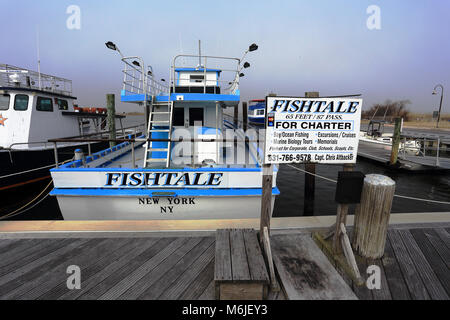 A fleet of charter fishing boats docked at the marina of for Charter fishing boats long island