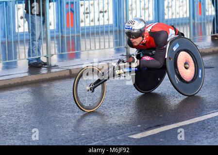 Marcel Hug racing in the Vitality Big Half marathon crossing Tower Bridge, London. Wheelchair race. Wheelchair para - Stock Photo