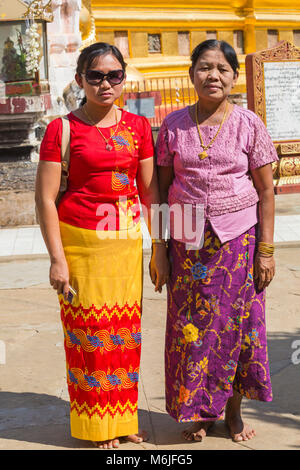 Visitors at Shwezigon Pagoda, Nyaung U, Bagan, Myanmar (Burma), Asia in February - Stock Photo