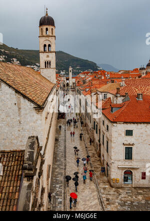 Looking onto the main street in old down Dubrovnik from the city wall - Stock Photo