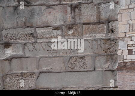 Latin writing carved on the stone - Stock Photo