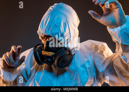 virus infection concept. Man in protective suit and antigas mask with glasses. Ebola, toxic gases, biological warfare, - Stock Photo