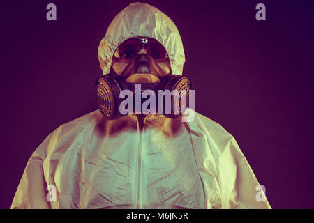 Scientist virus infection concept. Man in protective suit and antigas mask with glasses. Ebola, toxic gases, biological - Stock Photo