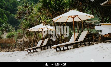 Sunbed on White Sand under Palms - Atuh Beach, Nusa Penida, Bali, Indonesia - Stock Photo
