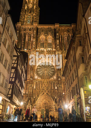 Strasbourg Cathedral rises between the street buildings - Stock Photo