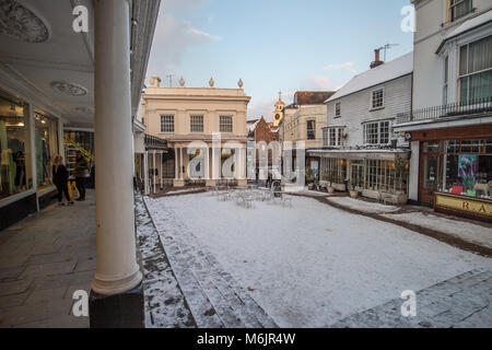 Tunbridge Wells Pantiles in winter 2018 with Beast from the East snow at sunset dusk with golden light - Stock Photo