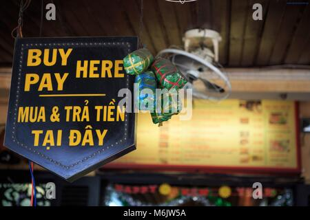 Signs in English for the many tourists who visit the Banh Mi Phuong restaurant in Hoi An, Vietnam - Stock Photo