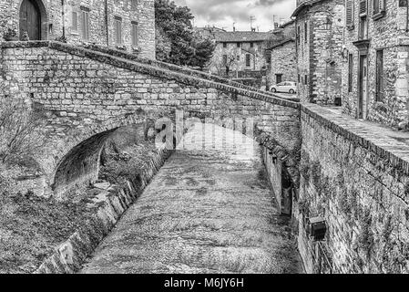 Walking in the picturesque and ancient streets of Gubbio, one of the most beautiful medieval towns in central Italy - Stock Photo