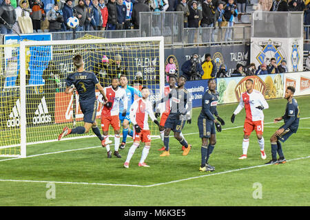 Soccer - football players jumping and leaping to head the ball during a Professional football - soccer match at - Stock Photo