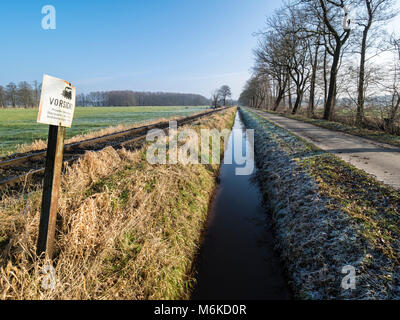 Railroad tracks of the OHE,  Osthannoversche Eisenbahnen, winter day, rural road, railway network, Lachtehausen, - Stock Photo
